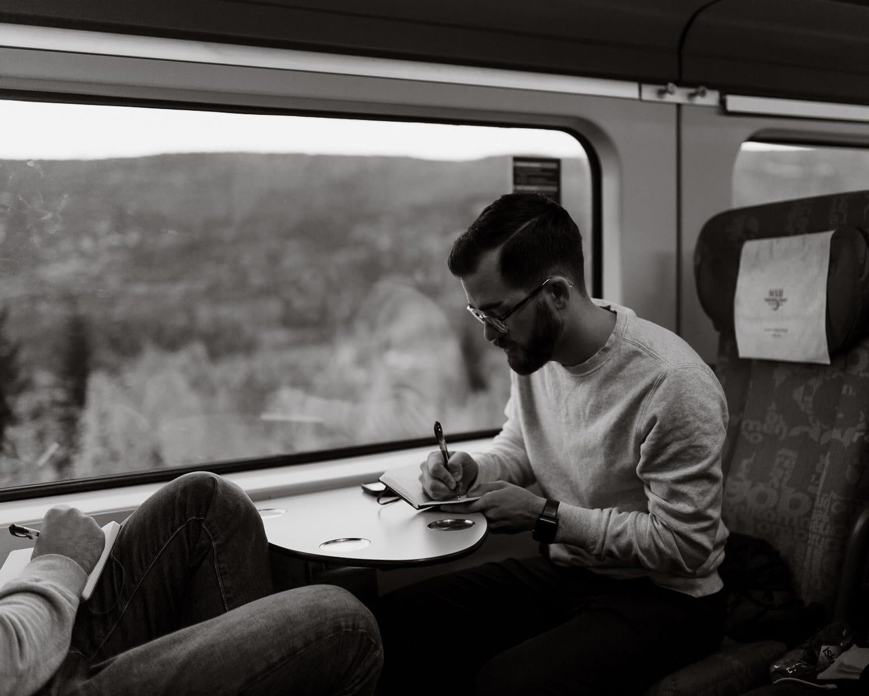 groom writes wedding vows on train