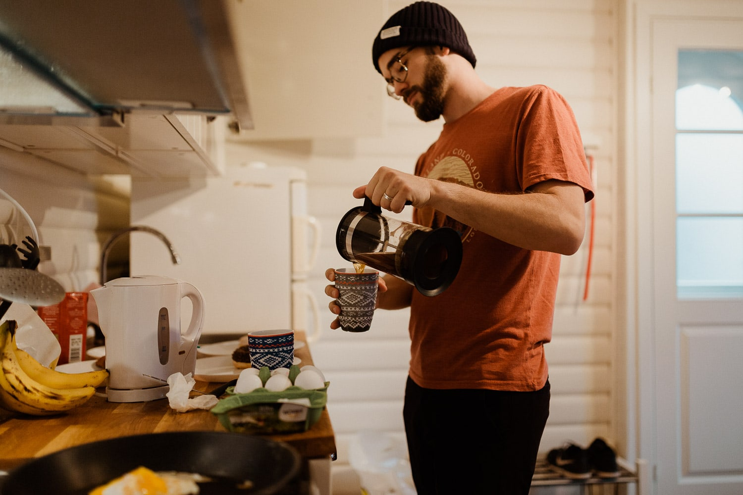 man making coffee for elopement morning at sunrise