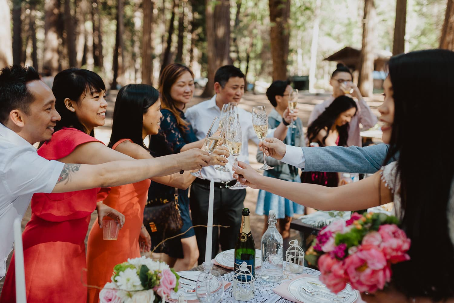 toasting champagne with family in forest