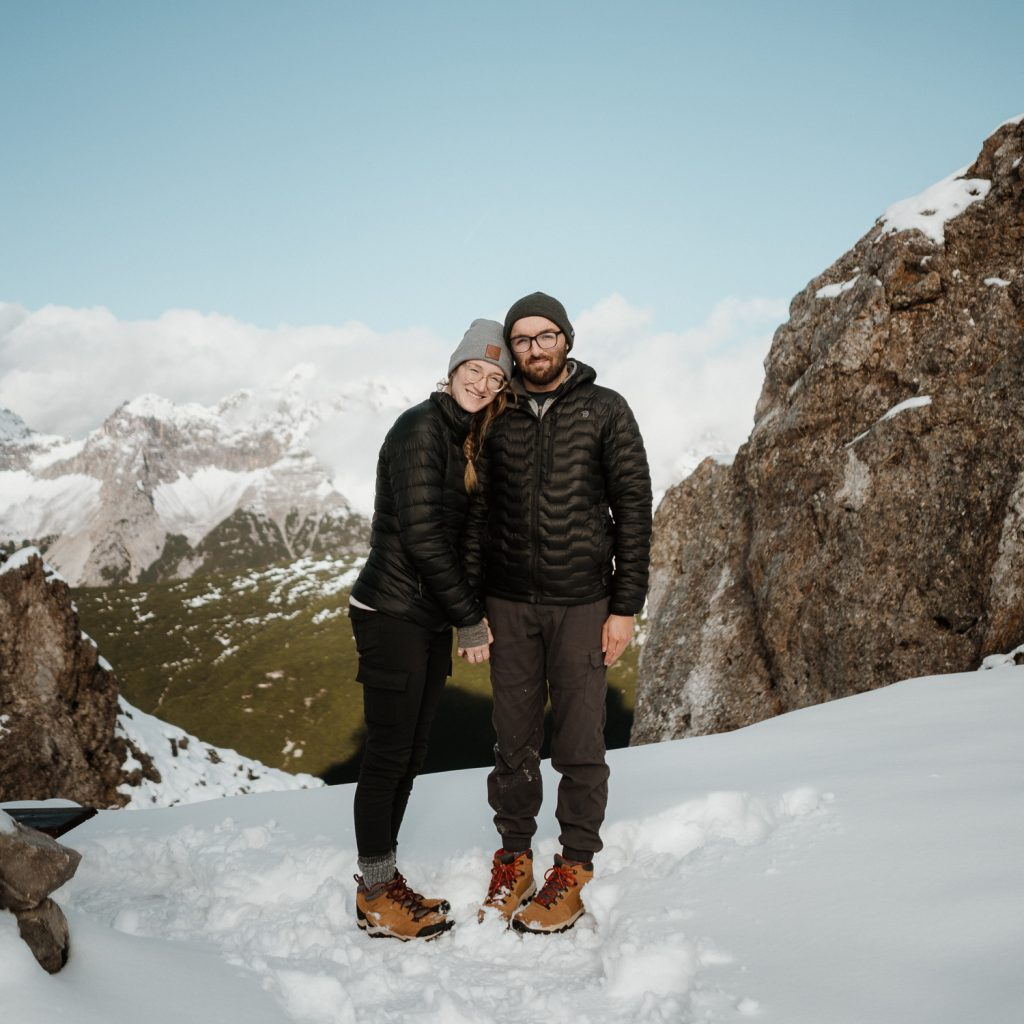 elopement photographer couple on snowy mountain trail