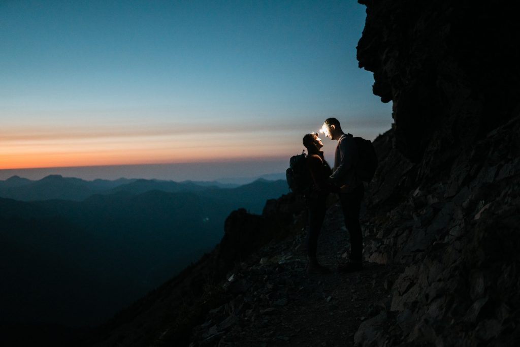 Couple using headlamps on hike in the Pacific-Northwest