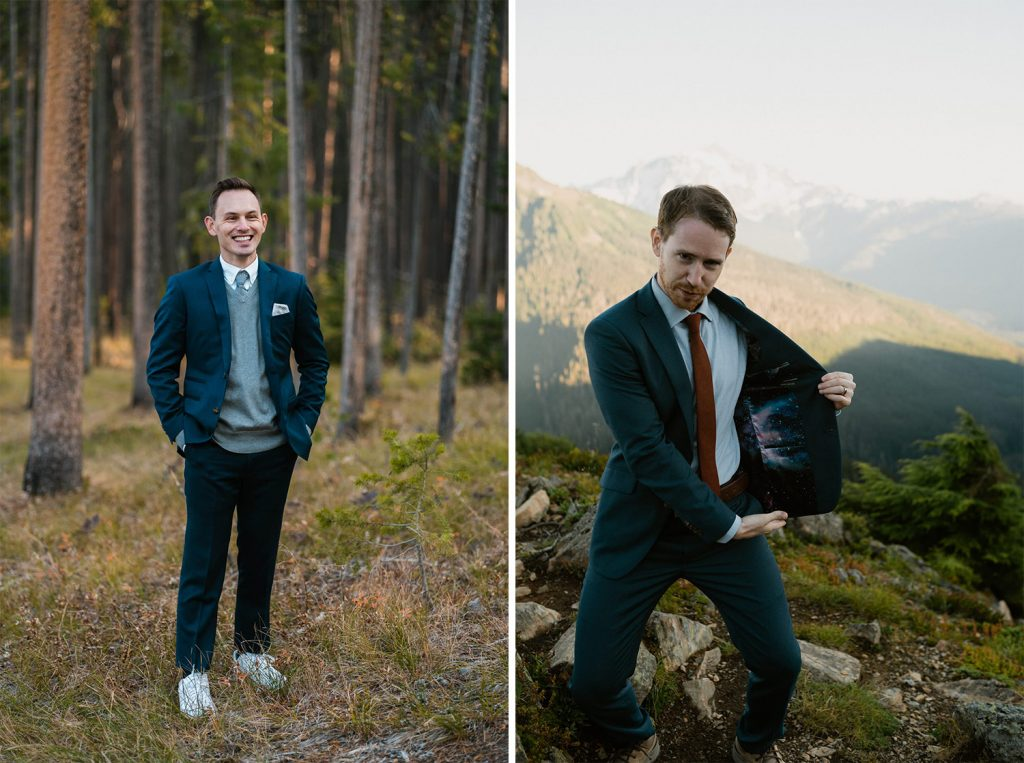 Groom in navy elopement suit standing in the forest