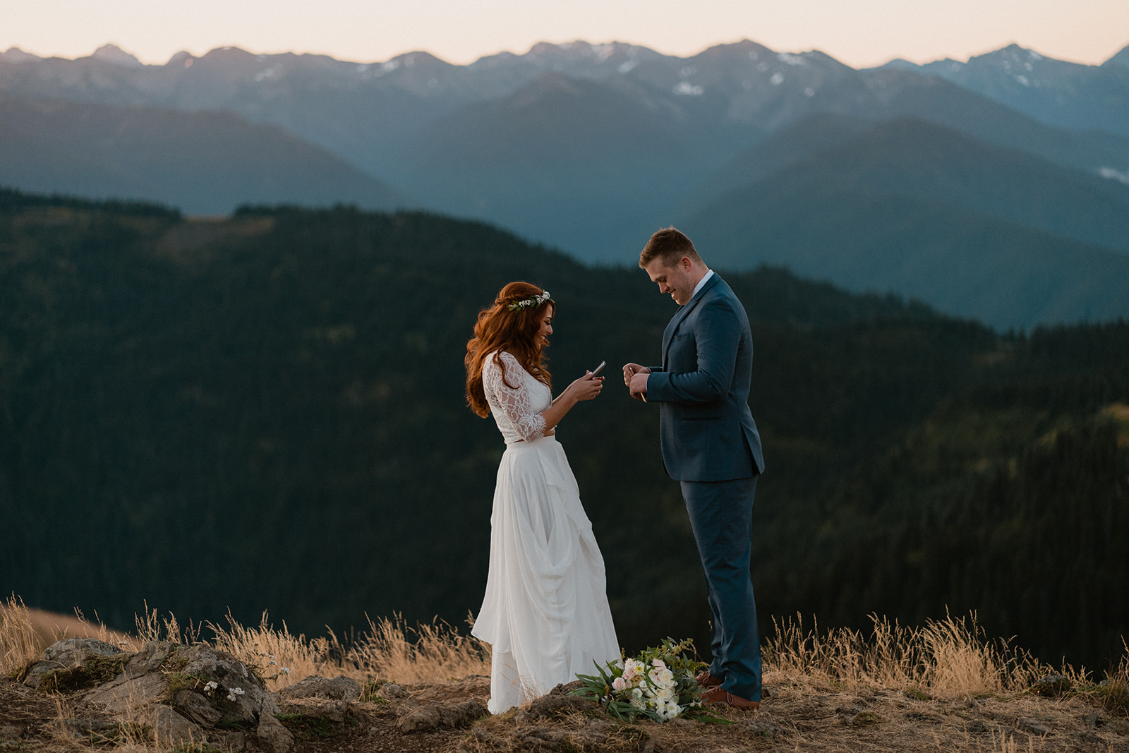 bride and groom exchanging vows in the mountains at sunrise